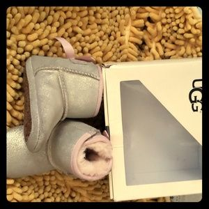 Silver with pink trim UGGS  size 2/3
